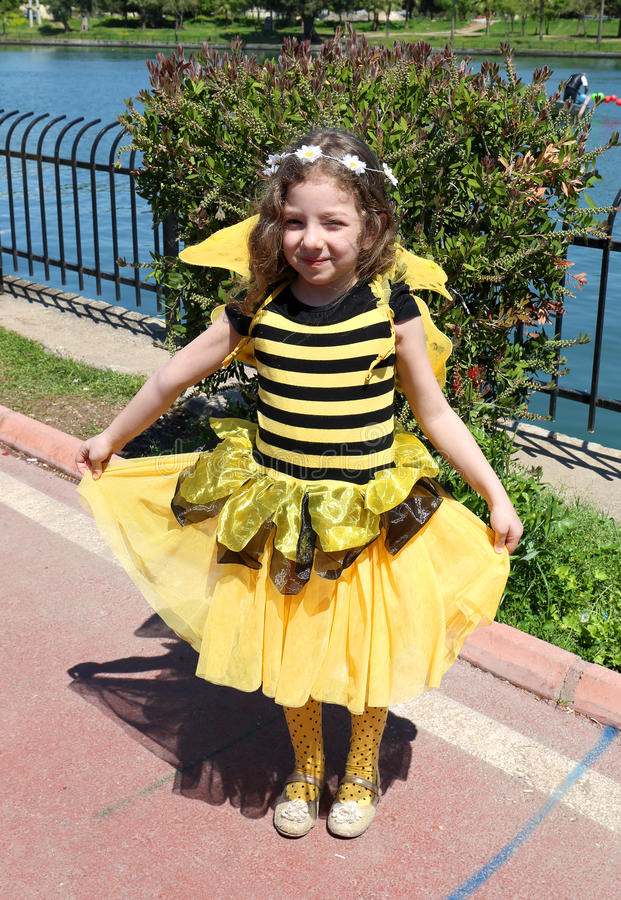 Unidentified Cute little girl with Bumble Bee costume posing at Orange Blossom Carnival stock photo