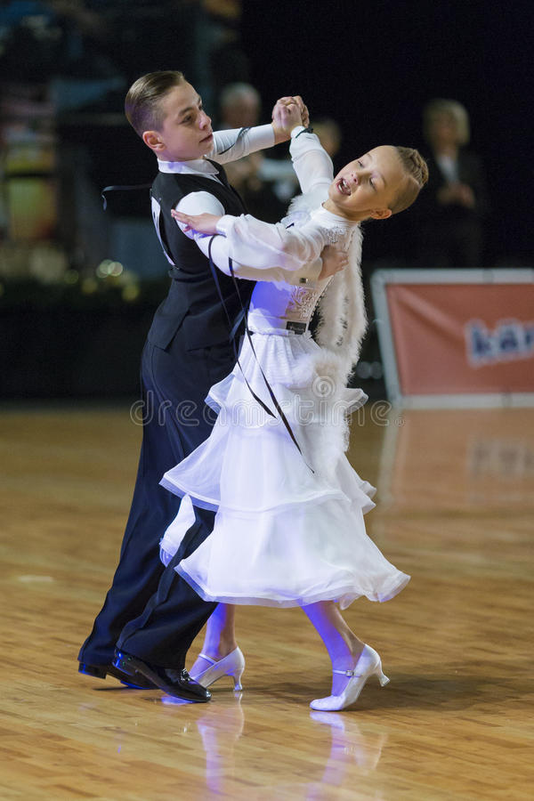 Download Unidentified Dance Couple Performs Juvenile-1 Standard European Program On The WDSF Baltic Grand Prix-2106 Editorial Stock Photo - Image: 83717213