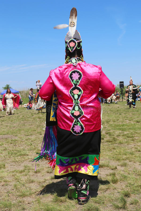 Unidentified female Native American dancer wears traditional Pow Wow dress during the NYC Pow Wow. NEW YORK - JUNE 8:Unidentified female Native American dancer stock photos
