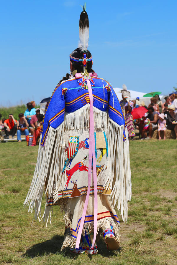Unidentified female Native American dancer wears traditional Pow Wow dress during the NYC Pow Wow. NEW YORK - JUNE 8:Unidentified female Native American dancer stock images