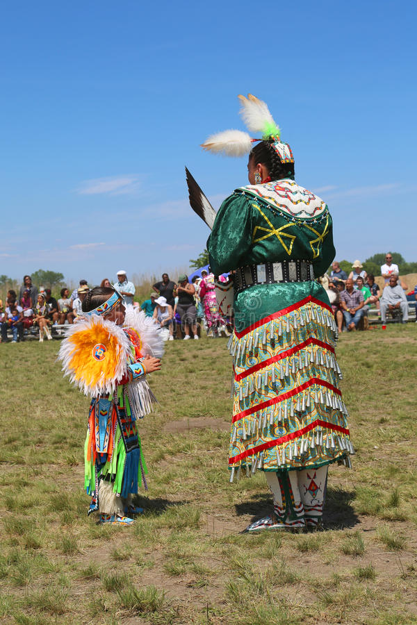 Unidentified female Native American dancer wears traditional Pow Wow dress during the NYC Pow Wow. NEW YORK - JUNE 8:Unidentified female Native American dancer stock photo