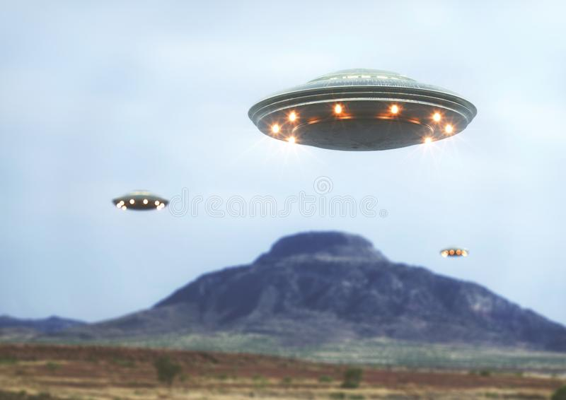 Unidentified Flying Objects UFO. Unidentified flying object over the desert with a mountain behind royalty free stock image