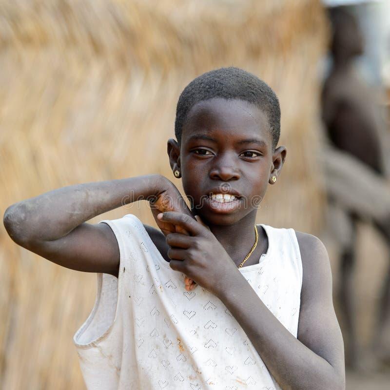 Unidentified Ghanaian Girl In White Shirt Looks Ahead In