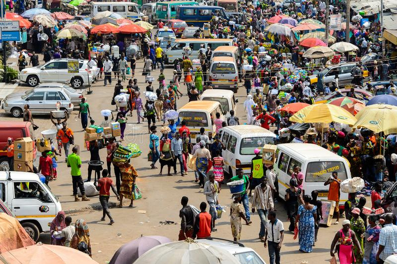 Unidentified Ghanaian people buy and sell goods at the Kumasi m royalty free stock images