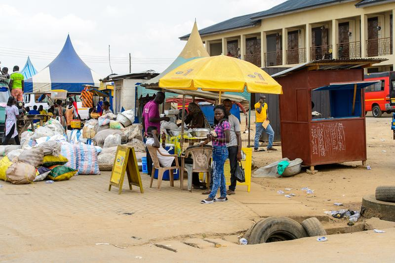 Unidentified Ghanaian people on the market in local village. Pe. CENTRAL REGION, GHANA - Jan 17, 2017: Unidentified Ghanaian people on the market in local stock photos