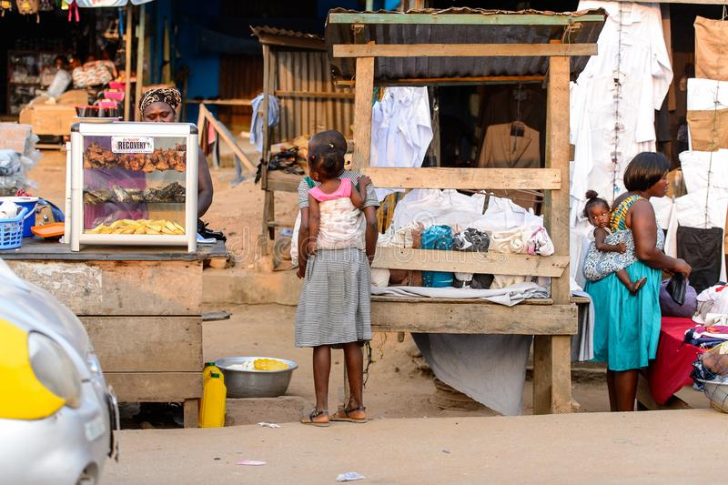 Unidentified Ghanaian woman sells food on the market in local v. CENTRAL REGION, GHANA - Jan 17, 2017: Unidentified Ghanaian woman sells food on the market in royalty free stock images