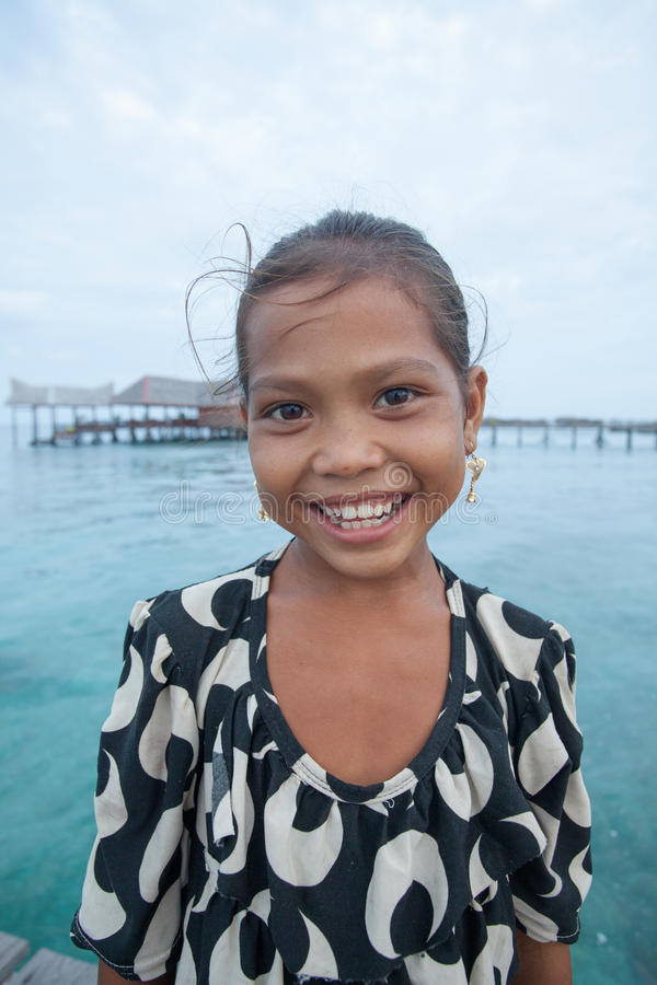 Unidentified girl of Sea Gypsies poses stock image