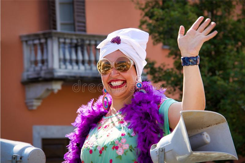 Unidentified happy woman participant during a local annual parade. Bettola, Italy - August 19,2018: unidentified happy woman participant during a local annual royalty free stock images