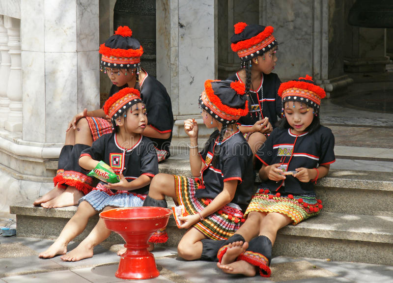 Unidentified hill tribe kids relax from dancing. royalty free stock image