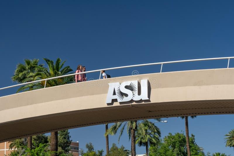 Unidentified Individuals Passing Overhead Bridge at Arizona State University stock images