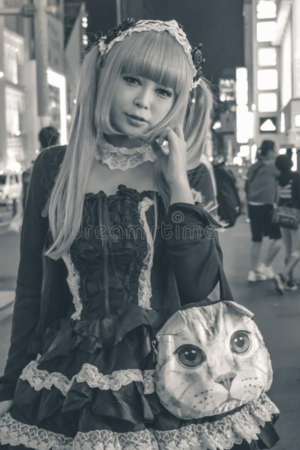 Unidentified Japanese girl in black costume and blonde dived hair Tokyo Japan royalty free stock photo