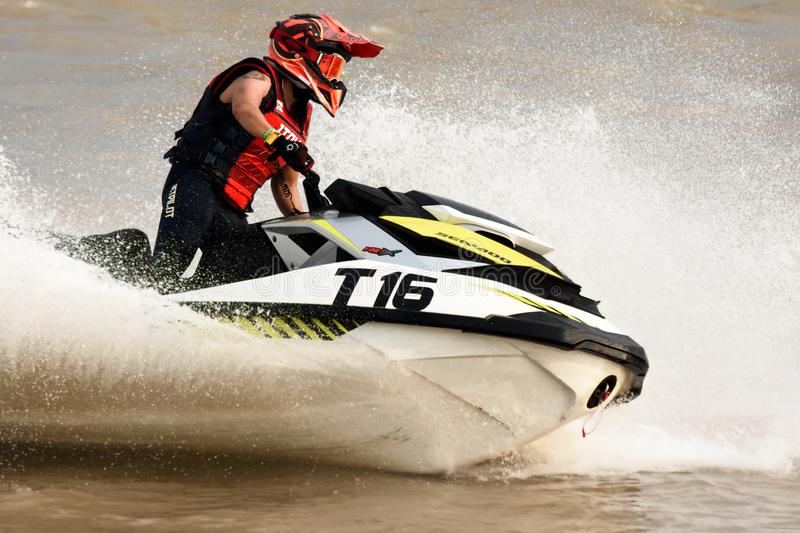 Unidentified jet ski racer at Jet ski pro tour #3, Udonthani, Thailand - May 25, 2019: Jet Ski competitor cornering at speed stock photo
