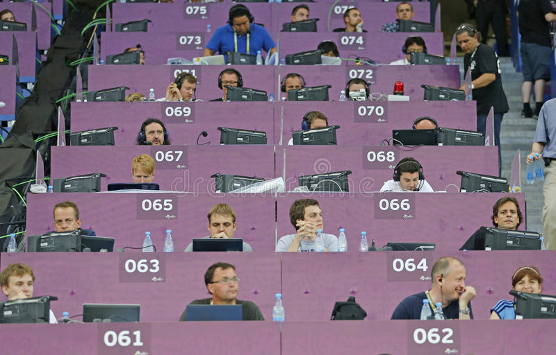 Unidentified journalists work at the stadium stock photo