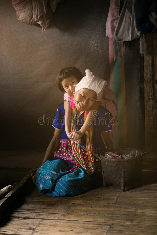 Unidentified Karen Long Neck woman with her baby from ethnic group of hill tribe minority of northern Thailand. Famous tourist tra royalty free stock photo