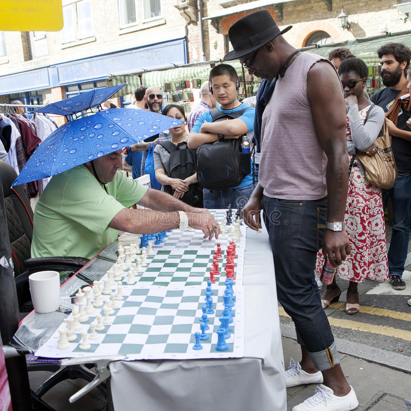 Unidentified local people played chess at Brick lane street in London UK. royalty free stock photo