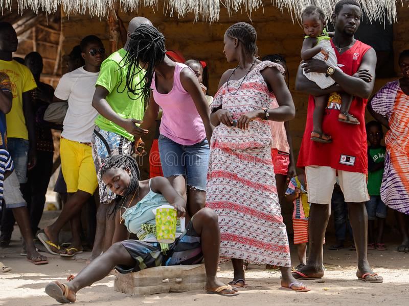 Unidentified local people stand in the Etigoca village. People. ORANGO ISLAND, GUINEA BISSAU - MAY 3, 2017: Unidentified local people stand in the Etigoca royalty free stock image