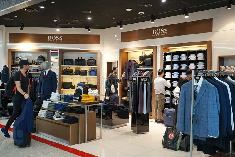 Unidentified males shopping at Hugo Boss luxury fashion store in Dubai International Airport stock image