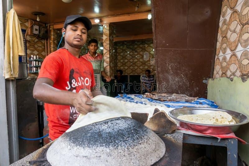 Unidentified Man baking an chapati roti at Chandni Chowk royalty free stock photo