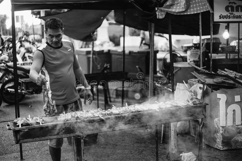 Unidentified man grilling chicken to sell in the thai traditional market Prachuapkhirikhan Province, Thailand. Prachuapkhirikhan,Thailand -January 24, 2016 royalty free stock image