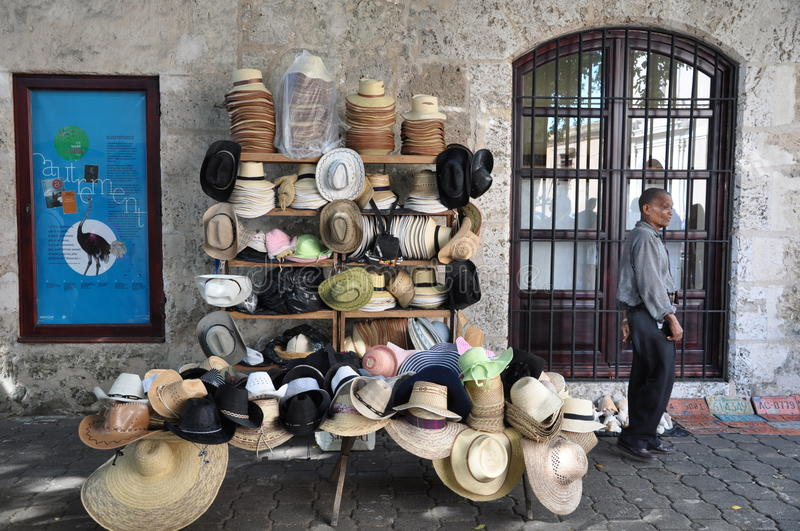 Unidentified man selling hats. In Colonial Zone, Santo Domingo, Dominican Republic royalty free stock image