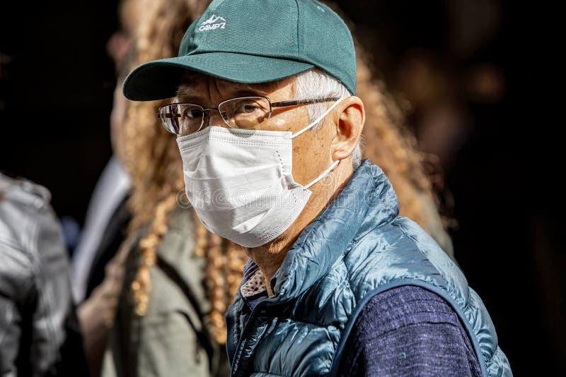 Unidentified man in Seville Spain wearing mask to prevent coronavirus spread stock image