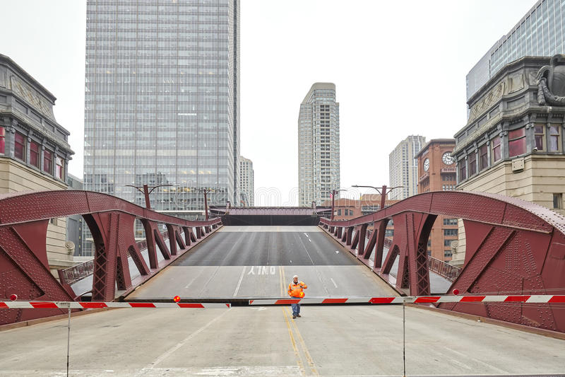 An unidentified man supervising the opening of movable bridge. royalty free stock image