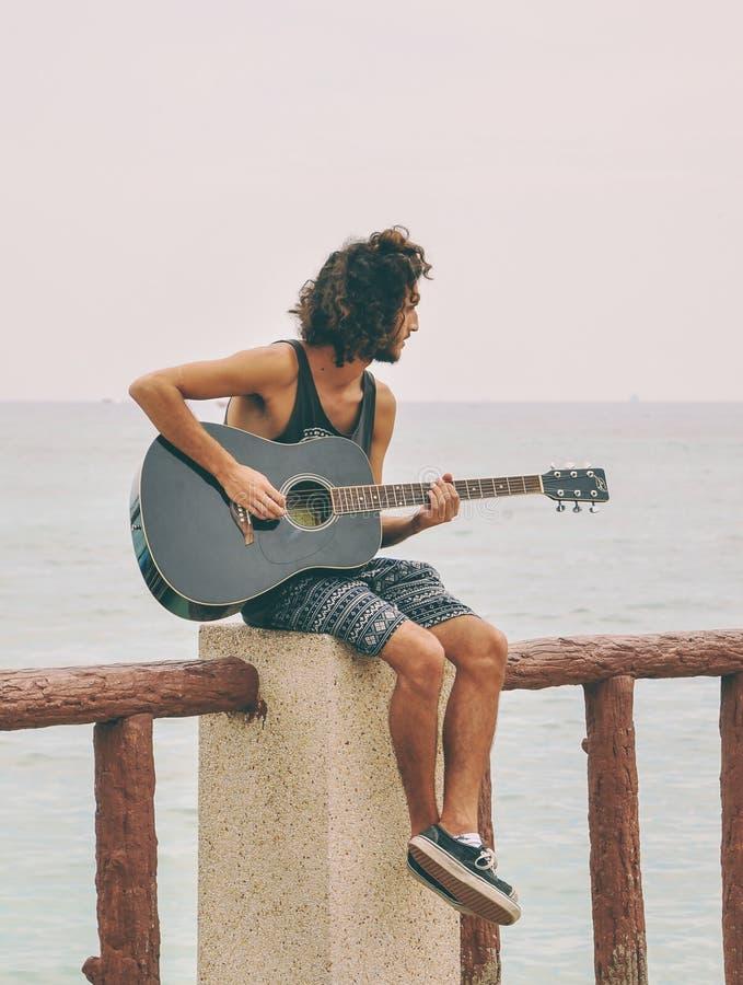 Unidentified man tourist playing the guitar stock photos