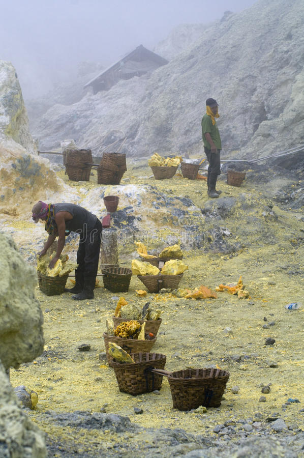 Unidentified miner harvests raw sulphur royalty free stock photo