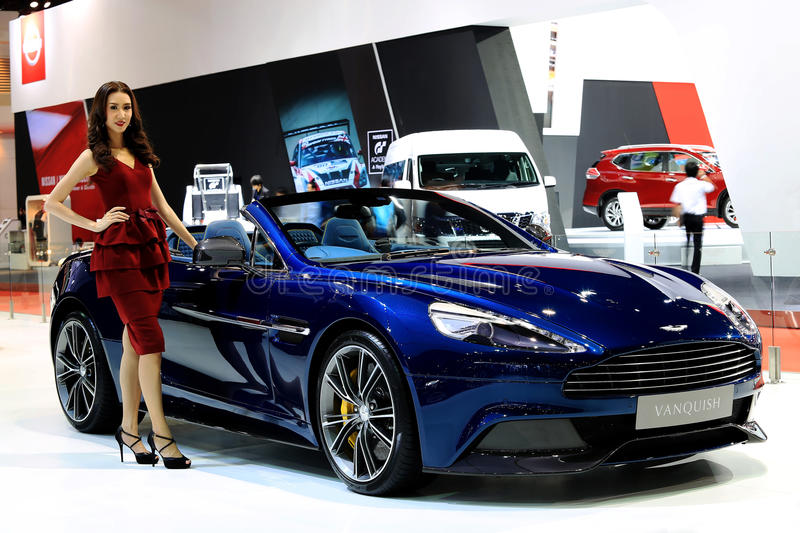 Unidentified model with blue Aston Martin series Vanquish. Bangkok - April 2 :unidentified model with blue Aston Martin series Vanquish- in display at The 36th royalty free stock images