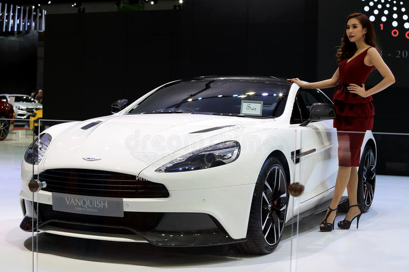 Unidentified model with white Aston Martin series Vanquish. Bangkok - April 2 :unidentified model with white Aston Martin series Vanquish carbon edition- in royalty free stock photo