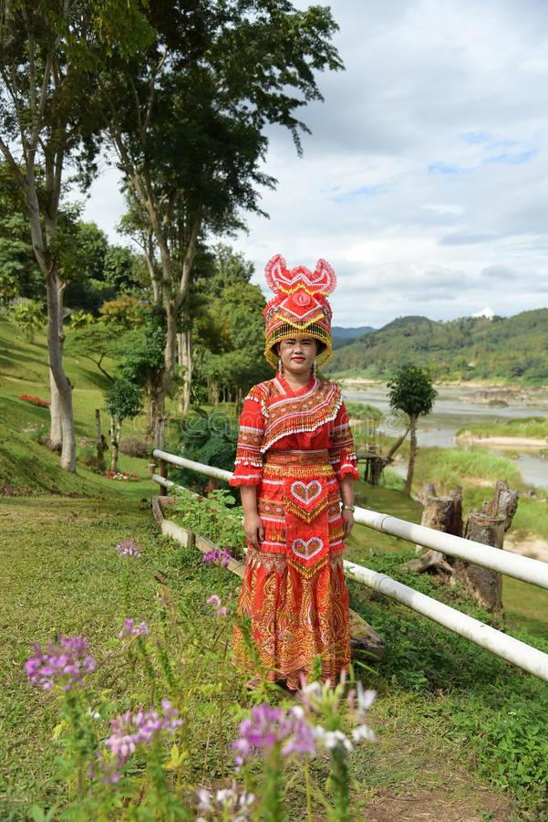Unidentified Mong tribe young woman with traditional clothes. CHIANG RAI,THAILAND - JANUARY 3 : Unidentified Mong tribe young woman with traditional clothes and royalty free stock images