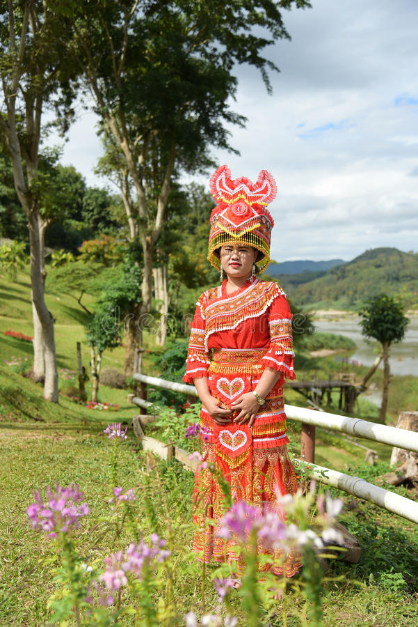 Unidentified Mong tribe young woman with traditional clothes and. CHIANG RAI,THAILAND - JANUARY 3 : Unidentified Mong tribe young woman with traditional clothes royalty free stock photography