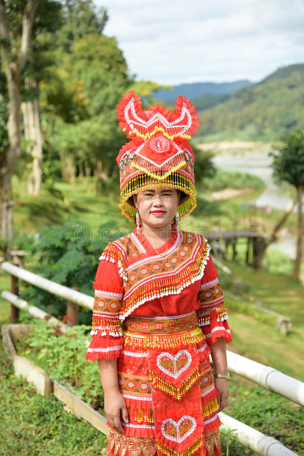 Unidentified Mong tribe young woman with traditional clothes and. CHIANG RAI,THAILAND - JANUARY 3 : Unidentified Mong tribe young woman with traditional clothes royalty free stock photo