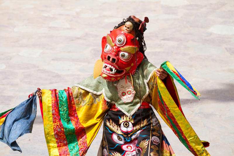Unidentified monk performs a religious masked and costumed mystery dance of Tibetan Buddhism. During the Cham Dance Festival in Hemis monastery, India royalty free stock photography