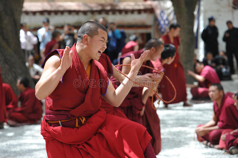 Unidentified monks debate at Sera monastery. LHASA - MAY 1: Unidentified monks debate at Sera monastery on May 1, 2013 in Lhasa, Tibet. Debating is part of the royalty free stock photography