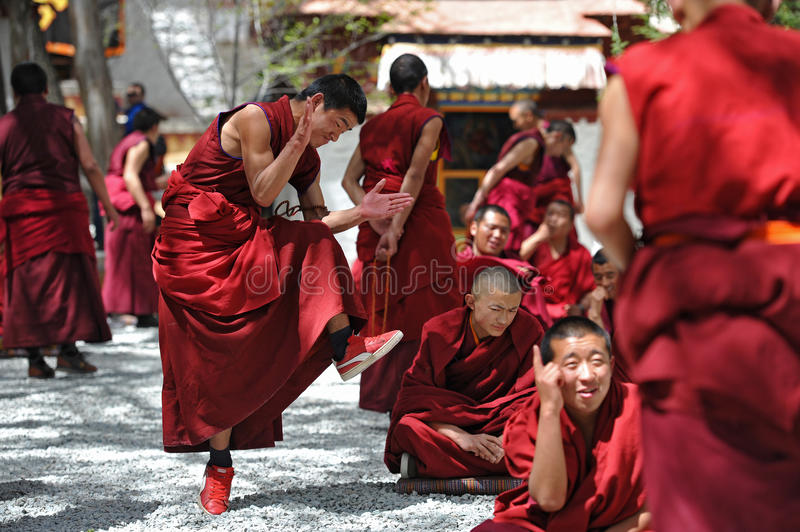 Unidentified monks debate at Sera monastery. LHASA - MAY 1: Unidentified monks debate at Sera monastery on May 1, 2013 in Lhasa, Tibet. Debating is part of the royalty free stock image