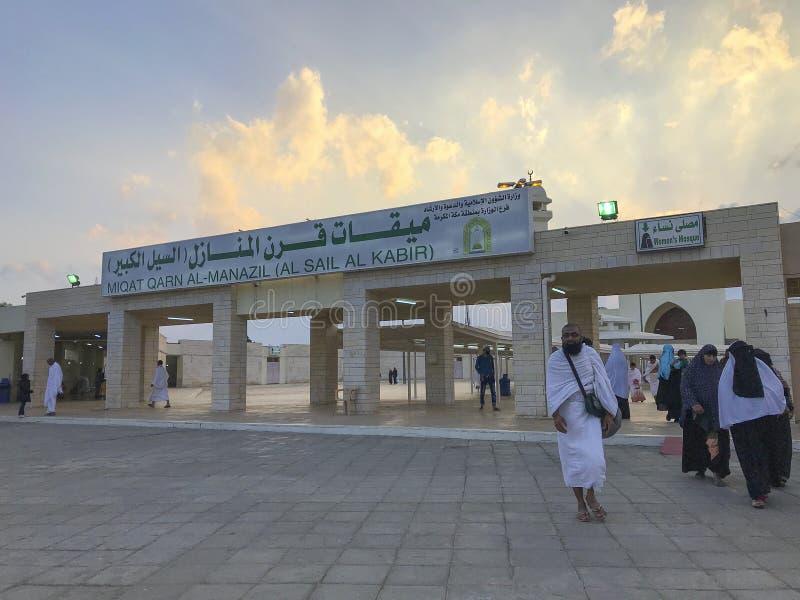 Unidentified Muslim pilgrims in white ihram cloth in Taif, Saudi Arabia. QARNUL AL MANAZIL, TAIF, SAUDI ARABIA-JANUARY 22, 2018: Unidentified Muslim pilgrims in stock image