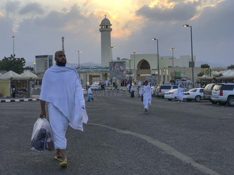 Unidentified Muslim pilgrims in white ihram cloth in Taif, Saudi Arabia. QARNUL AL MANAZIL, TAIF, SAUDI ARABIA-JANUARY 22, 2018: Unidentified Muslim pilgrims in stock photo