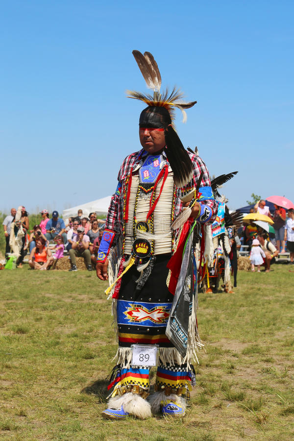 Unidentified Native American dancer at the NYC Pow Wow in Brooklyn. NEW YORK - JUNE 8, 2014: Unidentified Native American dancer at the NYC Pow Wow in Brooklyn royalty free stock images