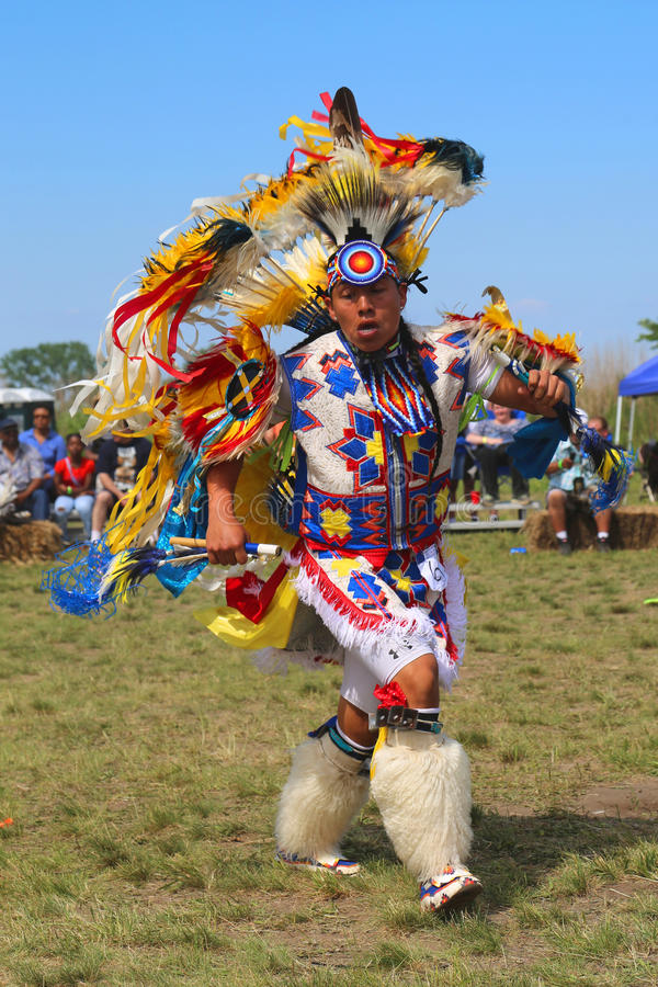 Unidentified Native American dancer at the NYC Pow Wow in Brooklyn. NEW YORK - JUNE 8, 2014: Unidentified Native American dancer at the NYC Pow Wow in Brooklyn royalty free stock photos