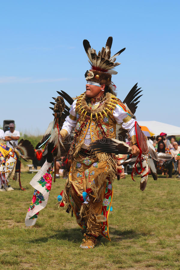 Unidentified Native American dancer at the NYC Pow Wow in Brooklyn. NEW YORK - JUNE 8, 2014: Unidentified Native American dancer at the NYC Pow Wow in Brooklyn stock photo