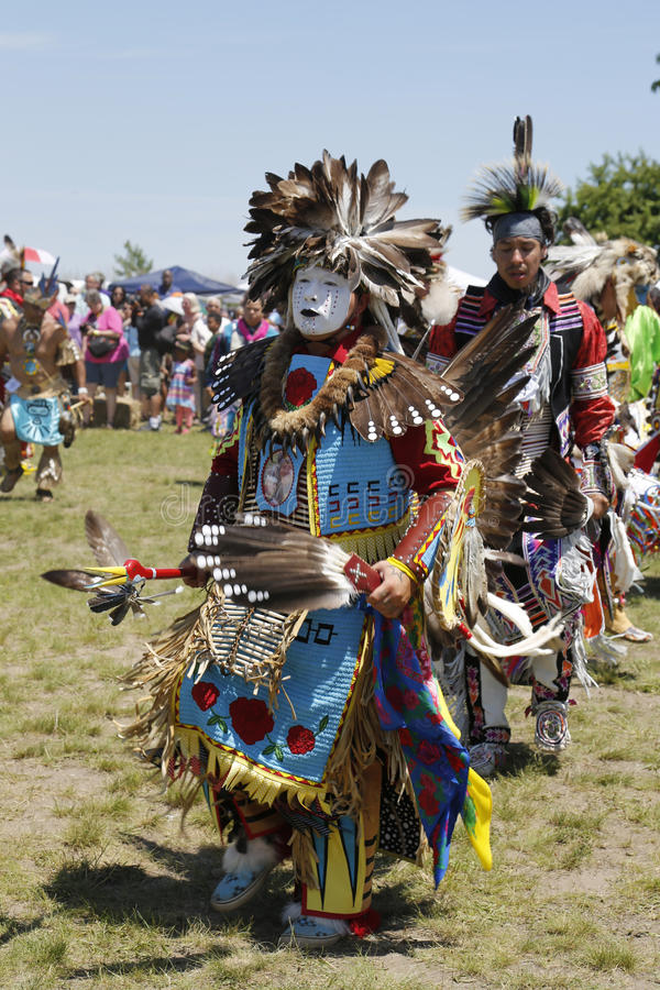 Unidentified Native American dancer at the NYC Pow Wow. NEW YORK - JUNE 8, 2014: Unidentified Native American dancer at the NYC Pow Wow in Brooklyn. A pow-wow is royalty free stock images