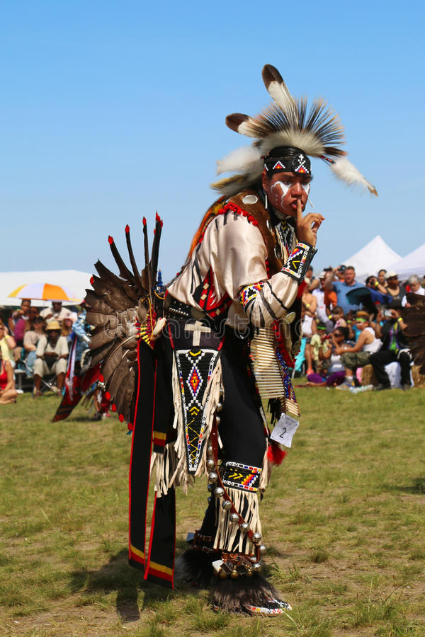 Unidentified Native American dancer at the NYC Pow Wow. NEW YORK - JUNE 8, 2014: Unidentified Native American dancer at the NYC Pow Wow in Brooklyn. A pow-wow is royalty free stock image