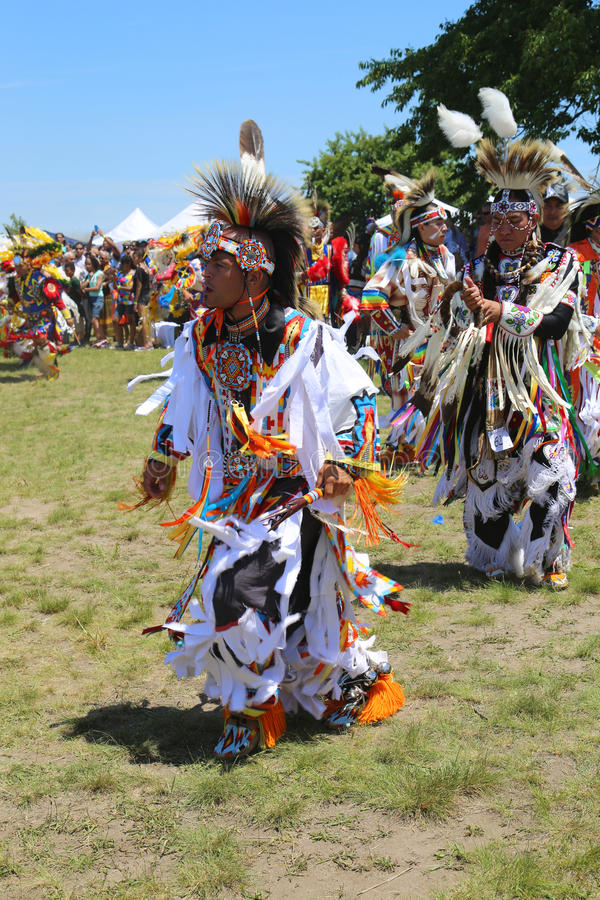 Unidentified Native American dancers at the NYC Pow Wow in Brooklyn. NEW YORK - JUNE 8 Unidentified Native American dancers at the NYC Pow Wow in Brooklyn on royalty free stock photo