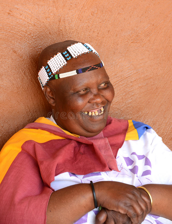 Unidentified Ndebele tribe woman wearing her traditional tribal clothing. stock image