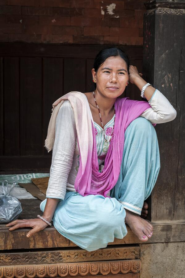 Unidentified Nepalese woman in Bhaktapur, Nepal, listed as a World Heritage by UNESCO for its rich culture and temples stock photography