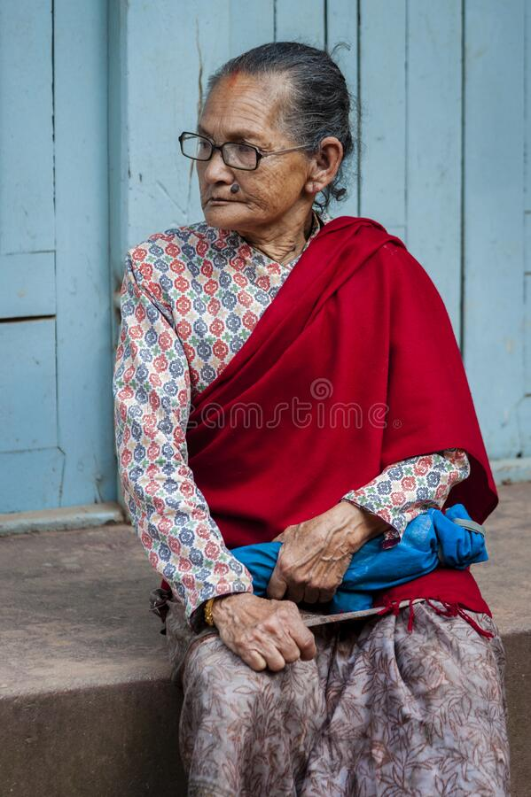 Unidentified Nepalese woman in Bhaktapur, Nepal, listed as a World Heritage by UNESCO for its rich culture and temples stock photo