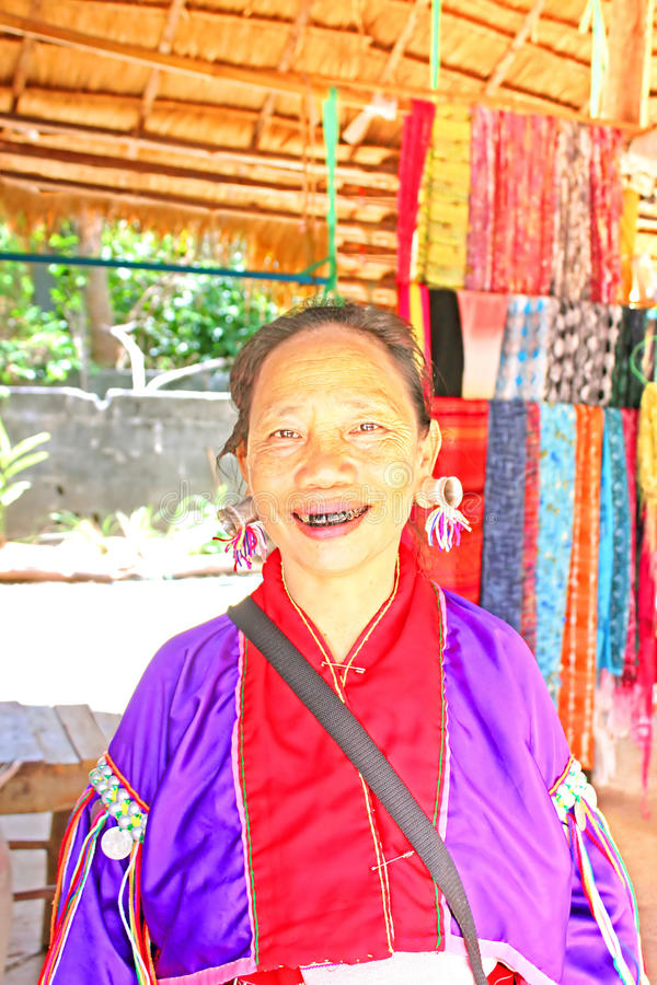 Unidentified Padaung (Karen) tribe woman in traditional costume near Mae Hong Son, Thailand. Chiang rai, Karen Long Neck hill tribe village royalty free stock image