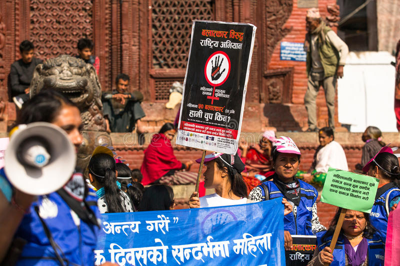 Unidentified participants protest within a campaign to end violence against women (VAW) Held annually since 1991. KATHMANDU, NEPAL - NOV 29, 2013: Unidentified royalty free stock photo