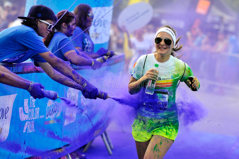 Unidentified people at The Color Run. MAMAIA, ROMANIA - JULY 26: Crowds of unidentified people at The Color Run on July 26, 2014 in Mamaia, Romania. The Color stock images